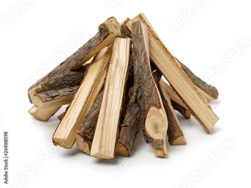 Slika na platnu Pile of firewood isolated on a white background