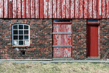 Red Door And Window On Brick Wall On Frøya An Island Outside Trondheim In Norway