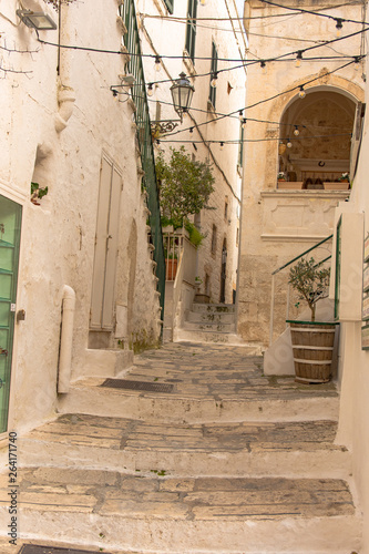 Fototapety, obrazy: Italy, Ostuni, a typical street in the ancient historic center