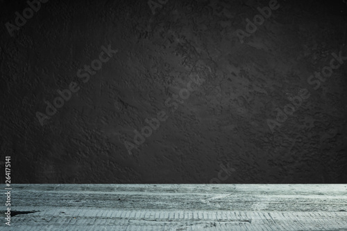 Fototapeta cement floor in dark room with spot light. black background. obraz na płótnie