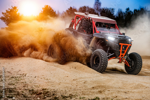 UTV buggy in the action on sand with sunshine Canvas Print