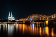 Cologne (Köln) with bridge and cathedral at night