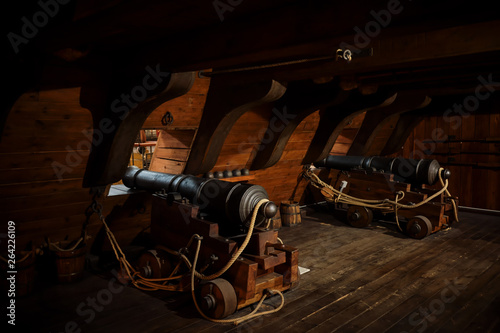 Staande foto Schip interior view of Cannons At The Deck and Cannon Balls plus windows on old galleon with ropes.