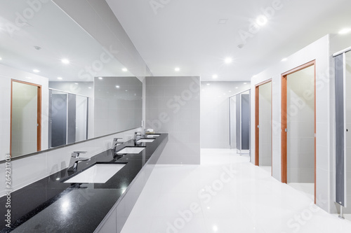 Fotomural  public Interior of bathroom with sink basin faucet lined up Modern design
