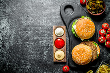 Burgers With Fries,tomatoes And Jalapenos In Bowl .
