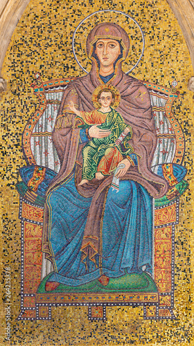 TAORMINA, ITALY - APRIL 9, 2018: The external mosaic of Madonna under Torre dell'Orologio (Porta di Mezzo) tower.