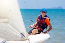 Man Sailing. Boy Learning To Sail On Sea Yacht.