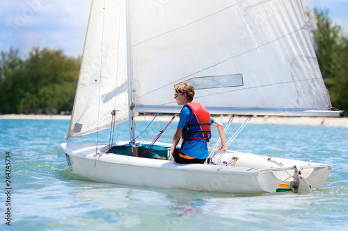 Garden Poster Sailing Child sailing. Kid learning to sail on sea yacht.