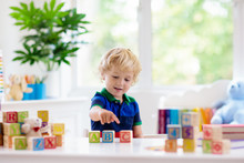 Child Learning Letters. Kid Wi...