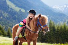 Kids Riding Pony. Child On Hor...
