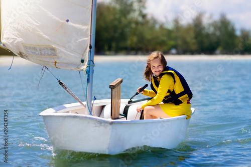 Fotografia  Child sailing. Kid learning to sail on sea yacht.