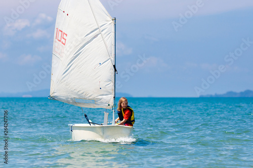 Garden Poster Child sailing. Kid learning to sail on sea yacht.