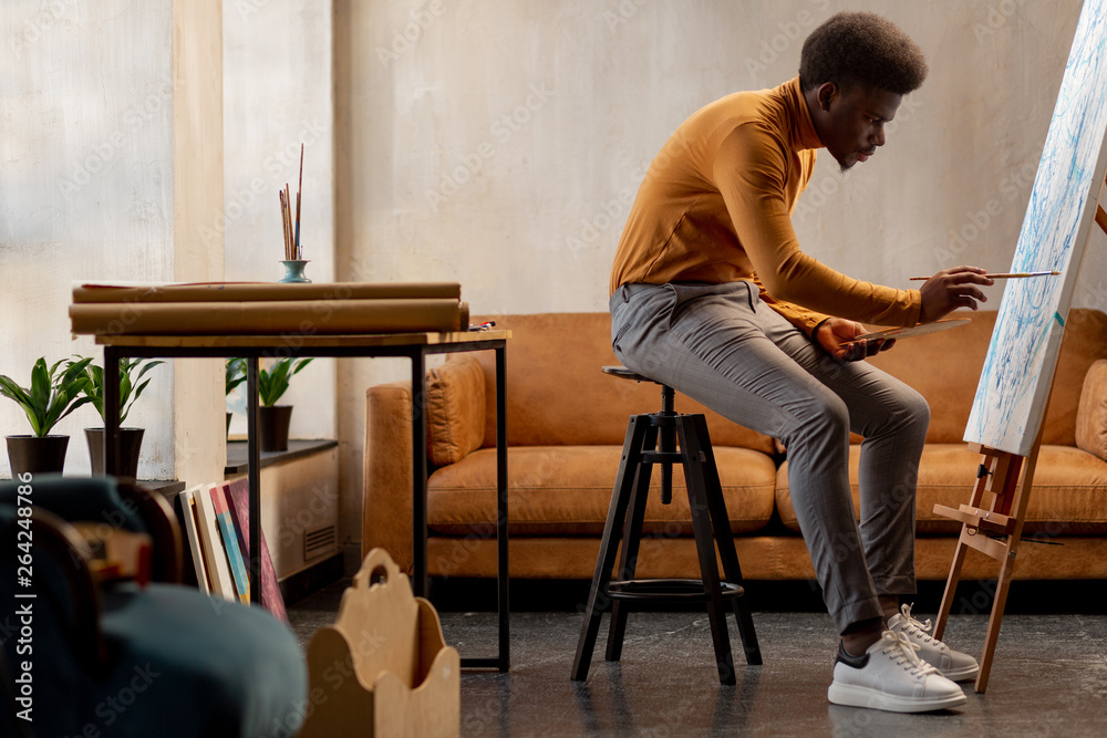 Fototapety, obrazy: Nice hard working artist concentrating on his painting