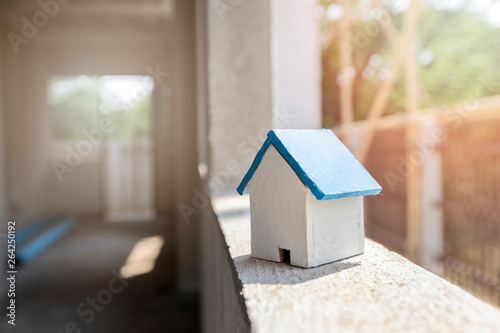 House Model On Window Frame In Housing Construction Site