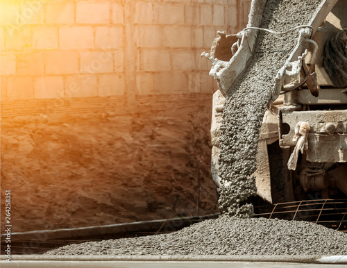 Fotografia  Pouring ready-mixed concrete after placing steel reinforcement