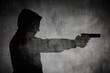 canvas print picture Silhouette von einem Mann mit Pistole