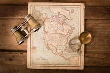 Binoculars And Compass On 1870 Map Of North America – World Travel