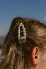 Pearl Hairpin In The Hair Of A Blonde Girl. Stylish Barrette
