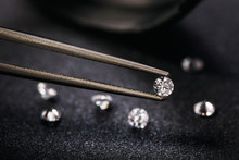 Gemstone Clamped In Tweezers. Jewelry Inserts Close-up
