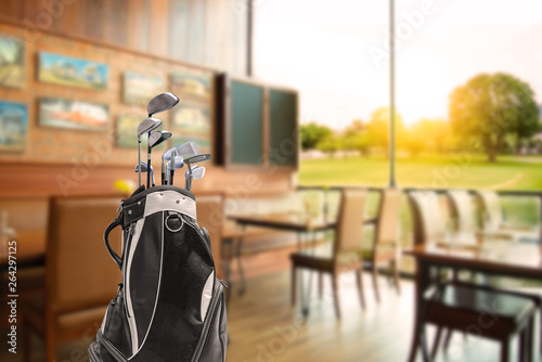 Fotografie, Tablou Golf bag  and golf clubs  of golfer have breakfast in club house restaurants at golf course