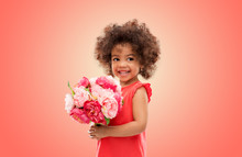 Childhood And People Concept - Happy Little African American Girl With Flowers Over Living Coral Background