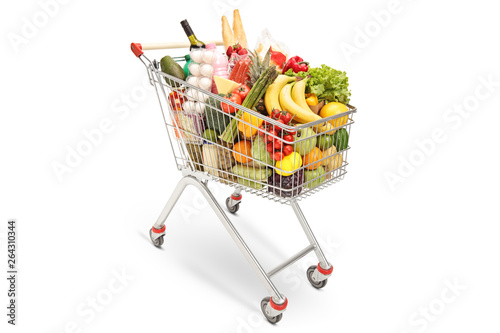 Shopping cart with different food products Fototapeta