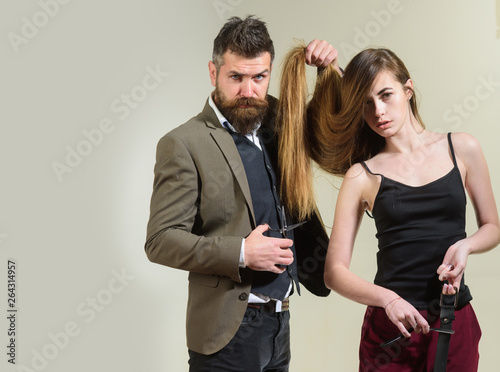 Fotografie, Obraz  Hairdresser makes hairstyle a woman with long hair