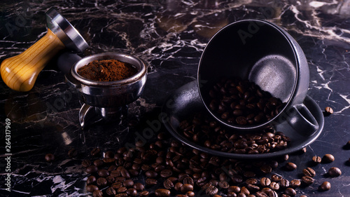 Poster Cafe coffee cup and grinder on black marble table