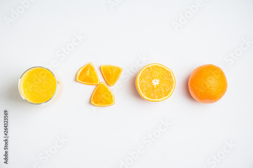 Stages of juice making from fruits to drink. Selective focus.