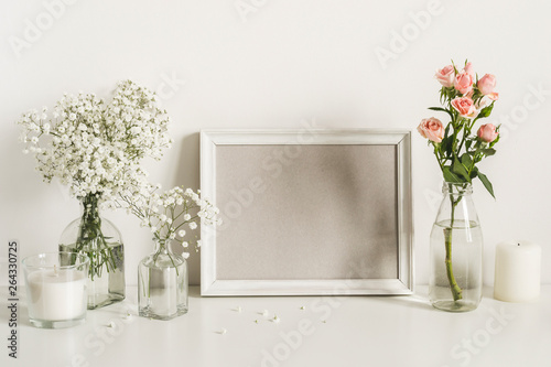 Romantic elegant flowers arrangement on table wall background. Template for text or artwork