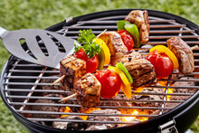 Grilling Colorful Kebabs Over ...