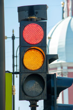 Traffic Light In A Big City, Red And Yellow Lights