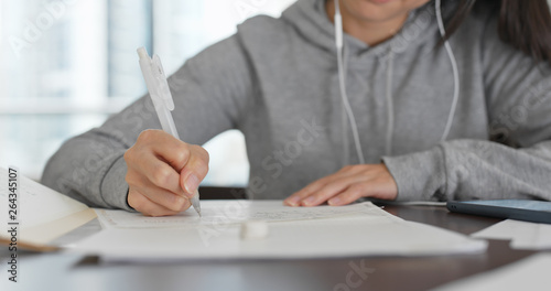 Fototapety, obrazy: Woman study on paper note with cellphone at home
