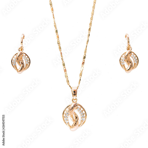 Wallpaper Mural gold necklace and ear rings jewelry isolated on white background