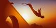Un homme aimant le sport extrême et les émotions fortes, se jette du haut d'un pont attaché à un élastique.