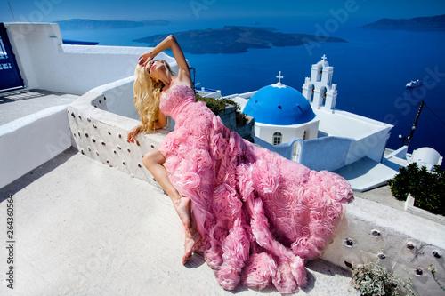 Fototapeta  Beautiful woman, bride in an elegant wedding dress, stands against the backgroun