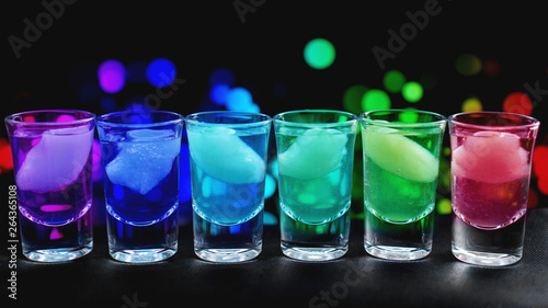 Fotografie, Tablou  Variation of hard alcoholic shots with ice served on bar counter