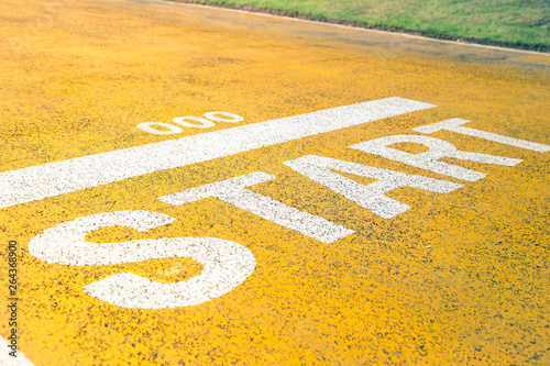 Running start signs painted on the road, good place for healthy. Wallpaper Mural