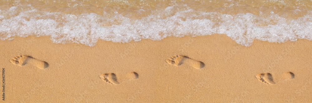 Fototapety, obrazy: Texture background Footprints of human feet on the sand near the water on the beach