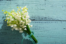 Lily Of The Valley Flowers On Cracked Blue Wood Table Background, Directly Above