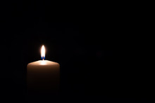 The Candle Burns On A Black Background