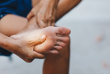 Young Woman Pain In Her Foot