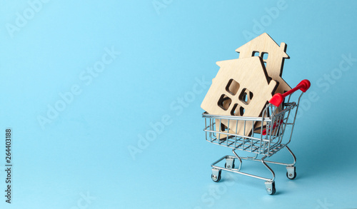 Shopping cart and house on a blue background Fototapeta