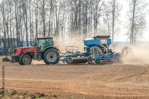 Fototapety, obrazy: Small farm with red tractor and plows in a field