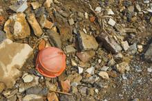 The Village Of Bayzhansay In The Turkestan Region Of Kazakhstan. Abandoned Mining Village. Protective Miner's Helmet Orange Lying On The Ground.