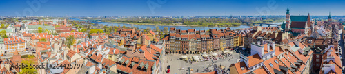 Historic cityscape panorama with high angle view of colorful architecture rooftop buildings in old town market square. Aerial