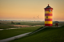 Pilsum Lighthouse On Dyke At N...