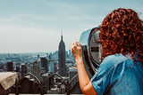 Fototapeta Nowy Jork - Young woman enjoying the New York skyline from high skyscrape in the morning. Travel photography