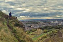 Photographer Shooting Edinburgh From Salisbury Crags, Scotland.