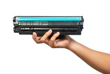 Used Laser Toner Cartridge Holding By Hand Of Worker Or User For Replace, Refill  With White Background. Laser Toner For Eco And Recycle Concept.